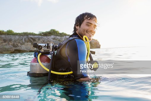 Man with scuba diving equipment in sea : Stock Photo