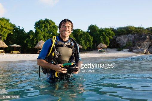 Man with scuba diving equipment in sea : Foto de stock