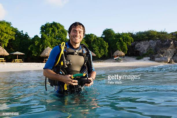 Man with scuba diving equipment in sea