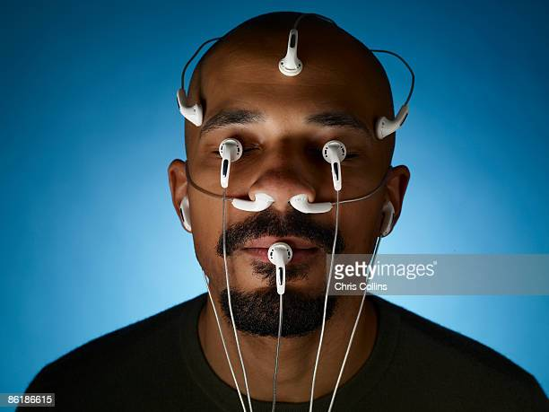 Man with sensors in eyes and mouth