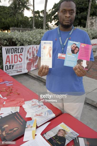 A man with sexually transmitted disease brochures for World AIDs Day