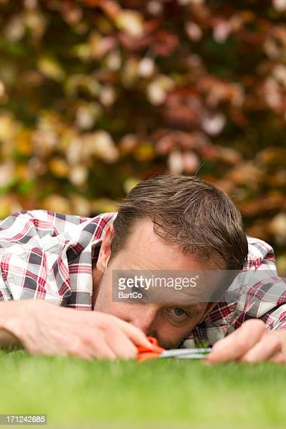 Man with shear on grass