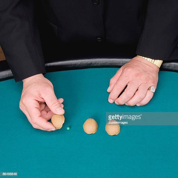 Man with shells and pea game