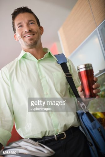 Man with shoulder bag and bike helmet : Stock Photo