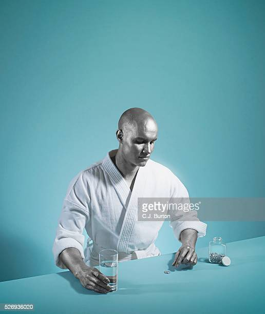 Man with Silver Colored Skin Taking Medicine
