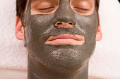 Man with skincare face mask