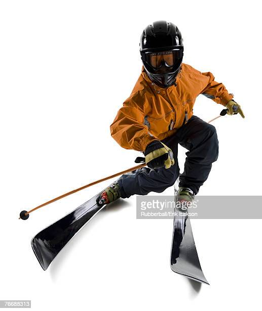 Man with skis helmet and poles