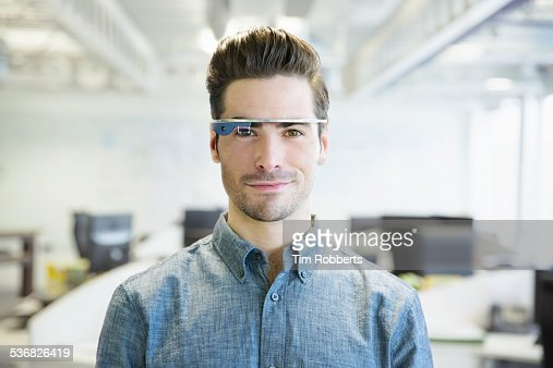 Man with smart glasses in office