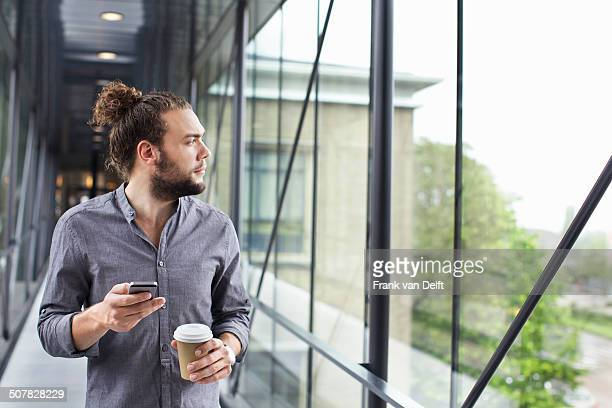 Man with smartphone on coffee break