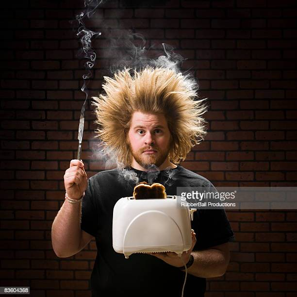 man with smoking toaster