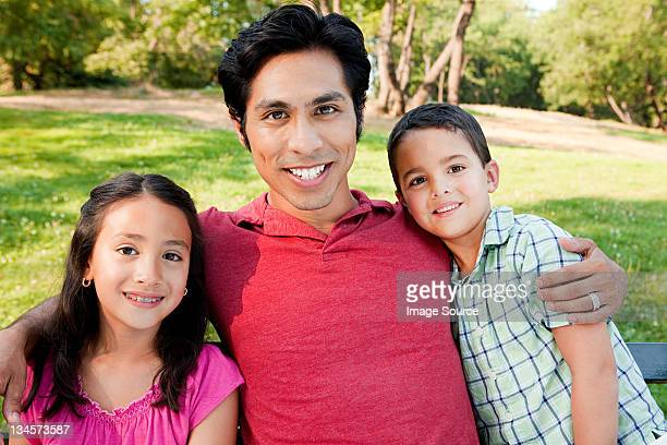 Man with son and daughter in park, portrait