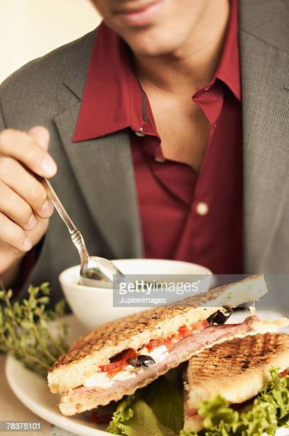 Man with soup and sandwich