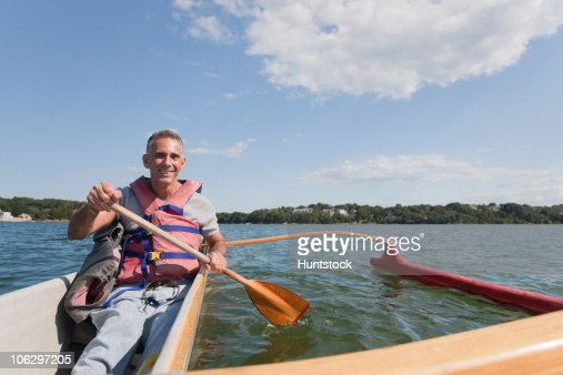 Man with spinal cord injury doing outrigger canoeing : Stock Photo