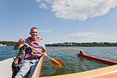 Man with spinal cord injury doing outrigger canoeing