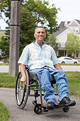 Man with spinal cord injury in a wheelchair enjoying outdoors