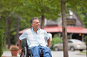 Man with spinal cord injury in a wheelchair out shopping