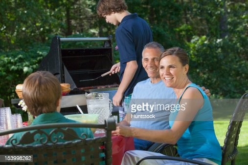 Man with spinal cord injury in wheelchair at family picnic : Photo