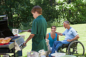 Man with spinal cord injury in wheelchair at family picnic