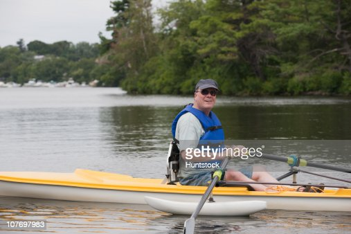 Man with spinal cord injury sitting in accessible boat