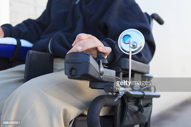 Man with spinal cord injury using his motorized wheelchair