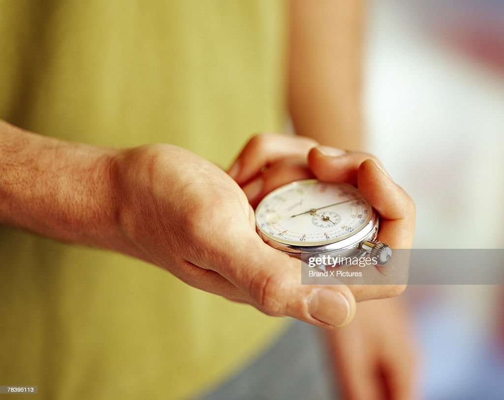 Man with stopwatch : Stock Photo