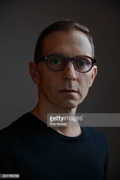 man with stylish glasses looking at camera