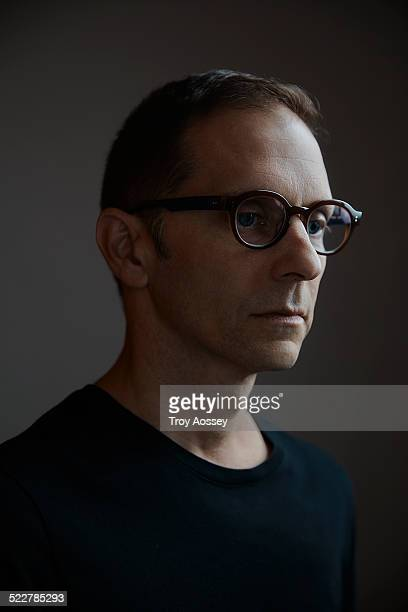 man with stylish glasses looking off camera
