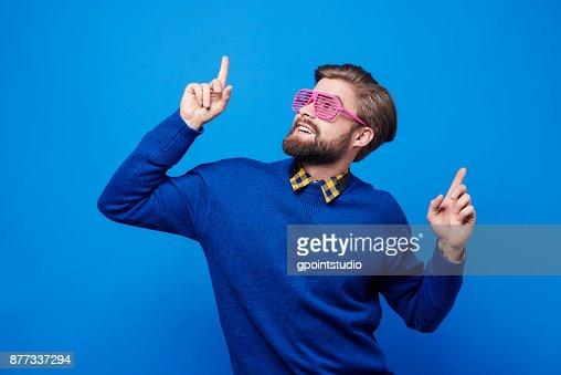 Man with sunglasses dancing at studio shot : Foto de stock