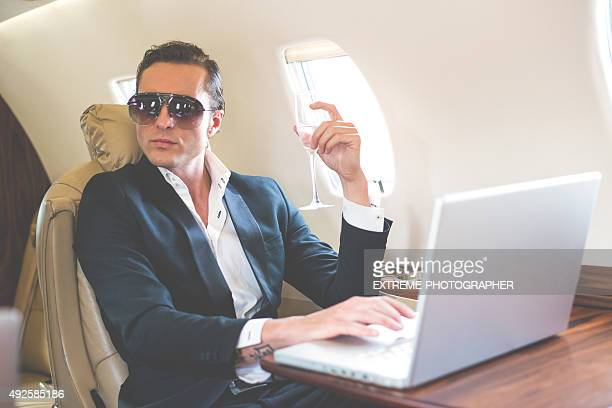 Man with sunglasses in private jet airplane