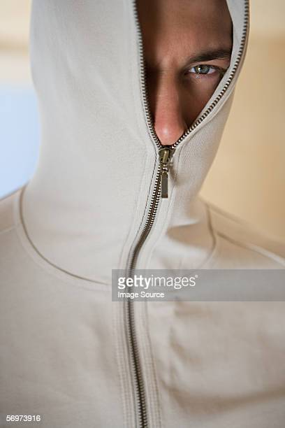 Man with sweater zipped up