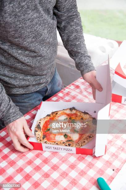 Man with takeaway pizza and box on 06th April 2017 in Dublin Republic of Ireland Dublin is the largest city and capital of the Republic of Ireland