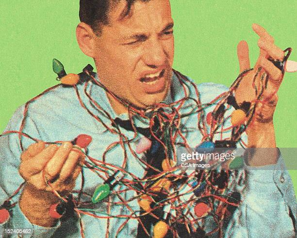 Man With Tangled Christmas Lights