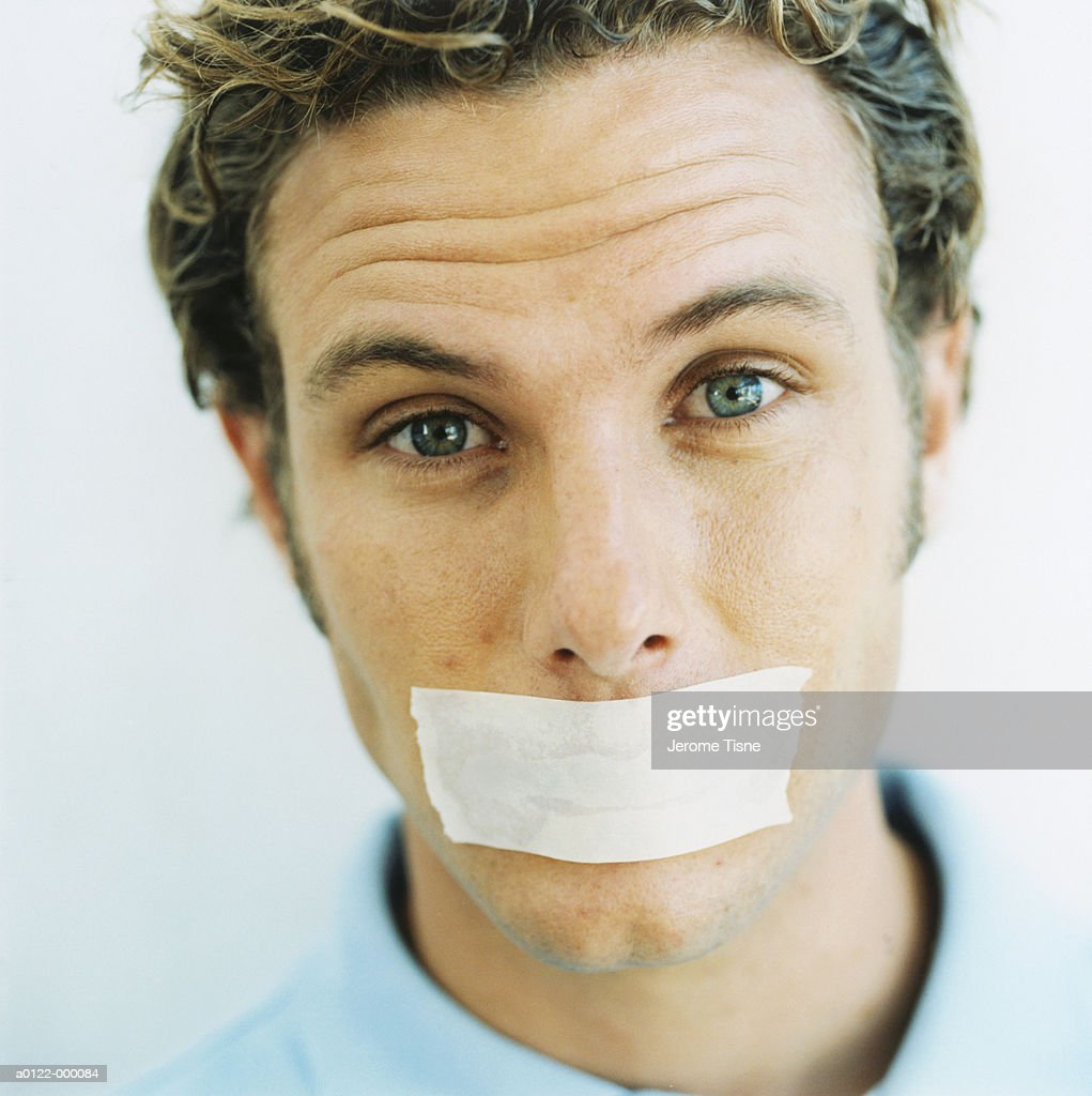 Man with Tape over Mouth : Stock Photo