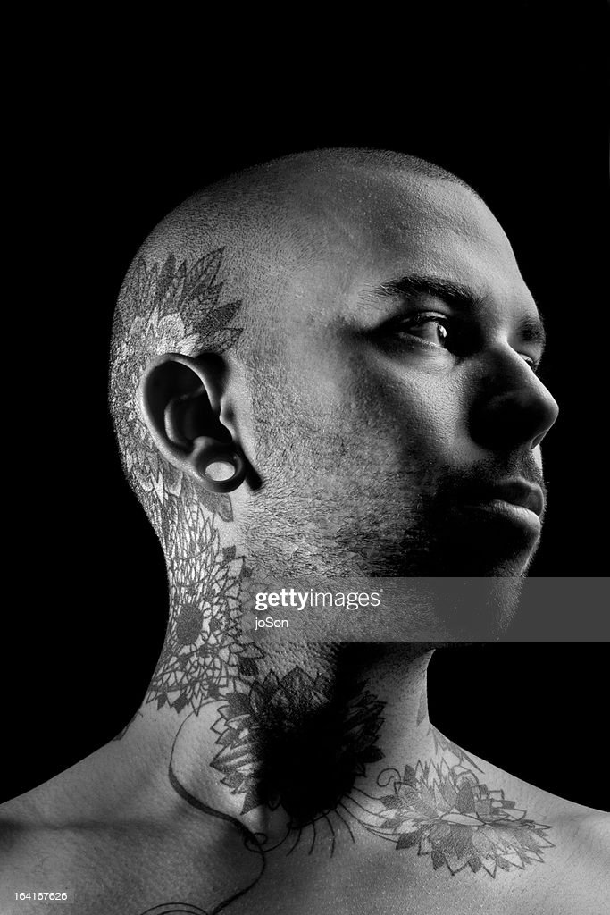 Man with tattoo, close-up, portrait : Stock Photo