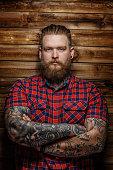 Huge man with beard and tattoos