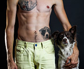 Man, tattoo of his dog, and his dog