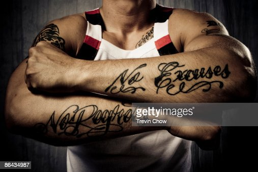 Man with tattoos on forearms