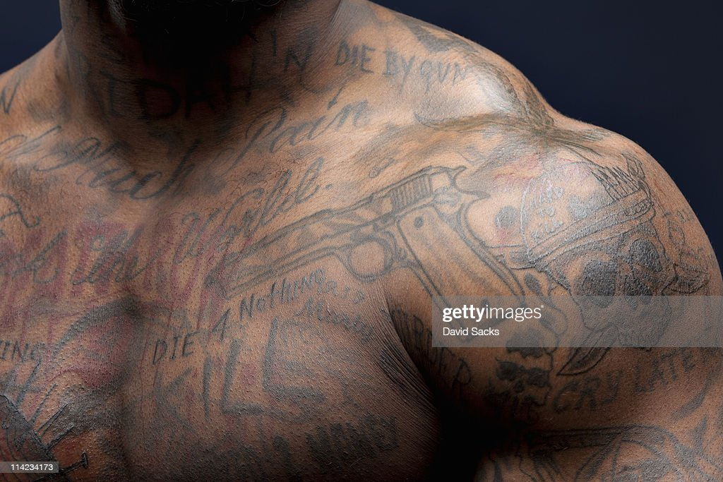 Man with tattoos, shoulder view : Stock Photo