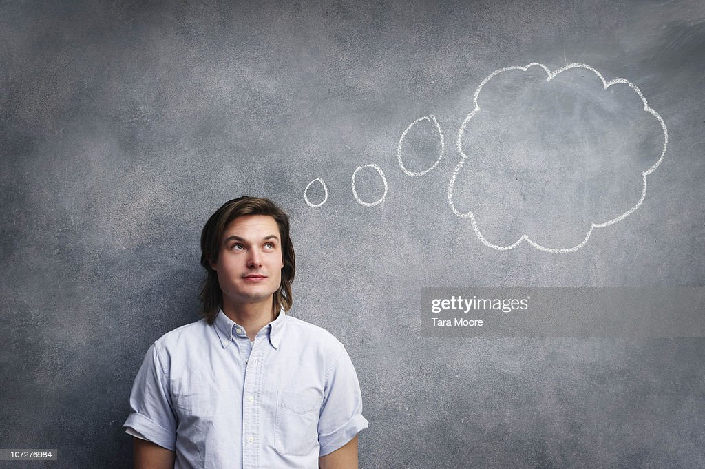 man with thought bubble on chalk board : Stock Photo