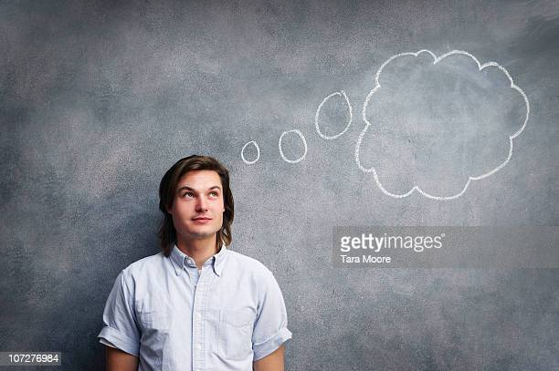 man with thought bubble on chalk board