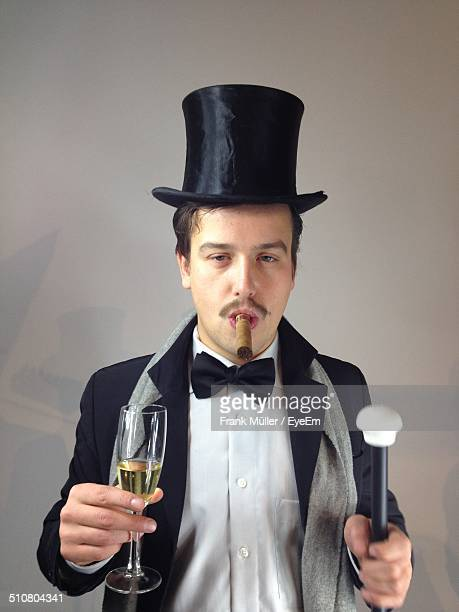 Man with top hat and cigar