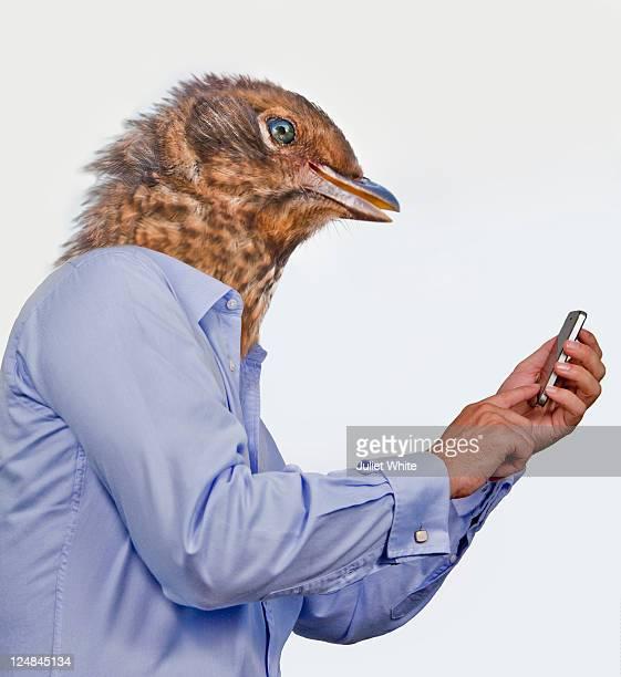 Man with Tweeting Bird Head using Mobile Phone