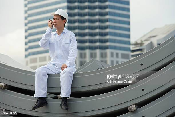 Man with walkie talkie giving directions