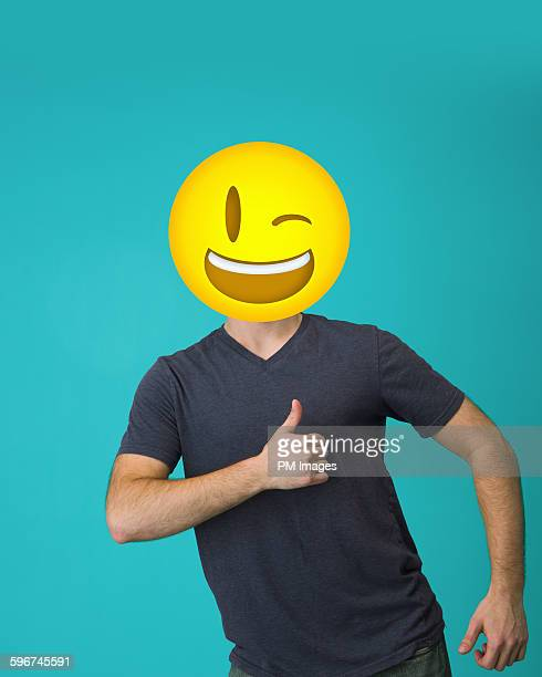 Man with winking emoji head