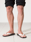 legs of a man with his flip-flop
