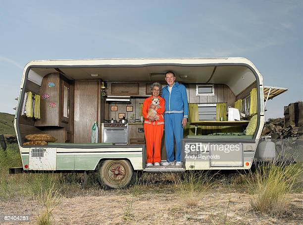 man, woman and dog in trailer