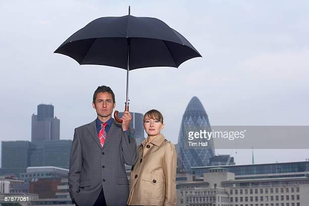 Man & Woman with Umbrella City Scape