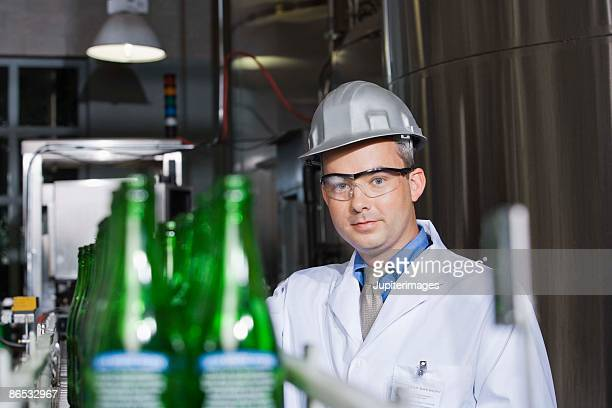 Man working an assembly line in a brewery