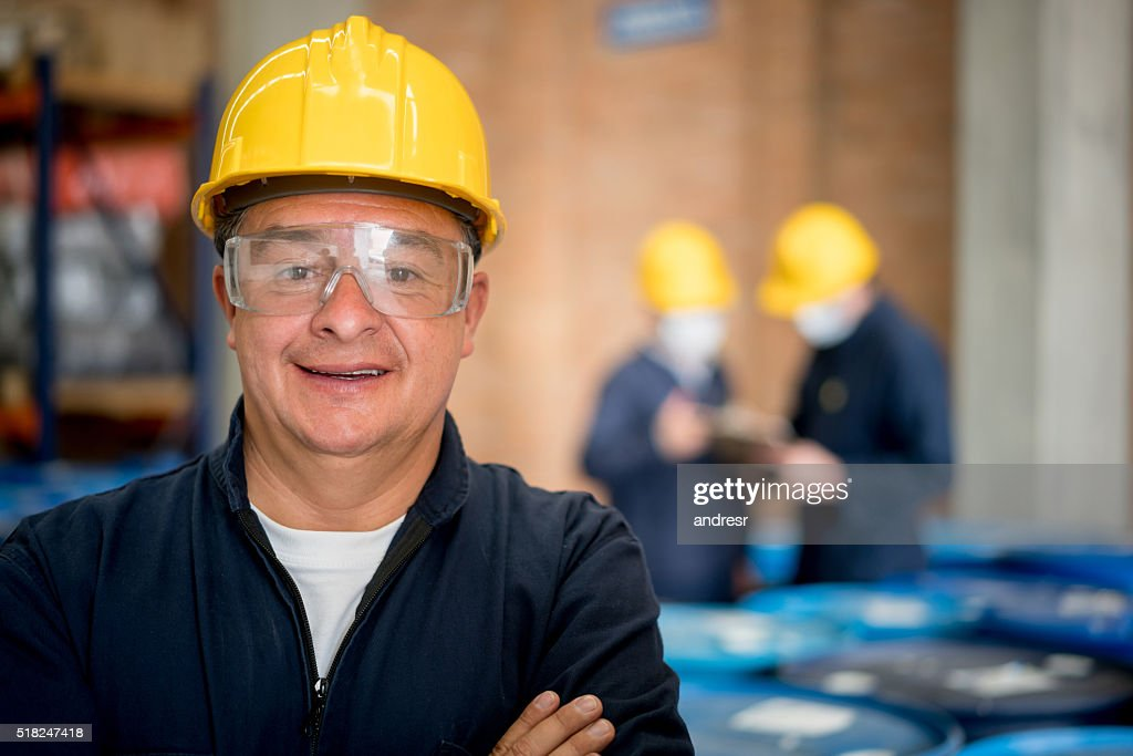Man working at a chemical plant : Stock Photo