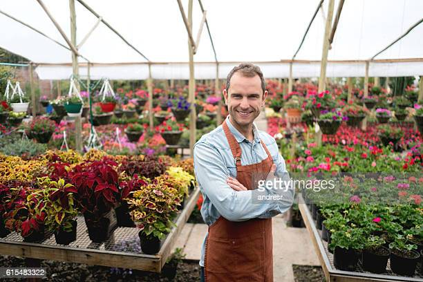 Man working at a greenhouse